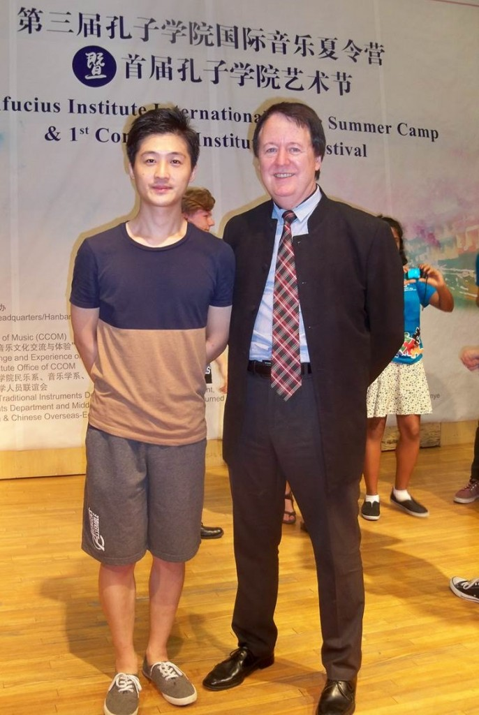 "With gifted young Chinese composer Sun Xiaosong, after July 6th 2016 closing concert at the Central Conservatory of Music, Beijing (CCOM). Sun Xiaosong wrote the piece titled ""Beside a Clear Spring – A Canadian Song Caprice,"" performed by the Carleton Chamber Orchestra together with the CCOM orchestra (traditional Chinese instruments) at the NAC Theatre on September 28, 2015, conducted by Barbara Clark, OC.  The piece incorporated three Canadian melodies: Leonard Cohen's ""Halleluiah,"" ""A la claire fontaine"" and ""O Canada"" http://newsroom.carleton.ca/2015/09/25/carleton-musicians-join-chinese-music-soiree-at-national-arts-centre/ http://en.ccom.edu.cn/wn/news/2015f/201511030003.shtml"