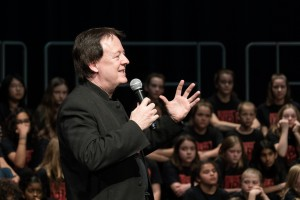 "James Wright speaking to ""Listen Up"" audience and choristers (May 2017)"