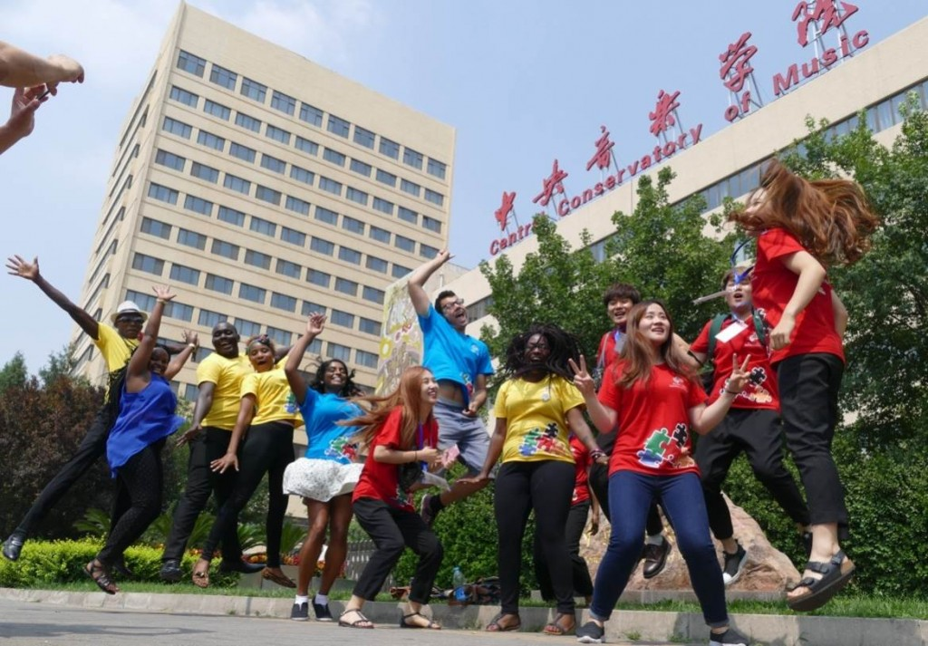 Music students from Kenya (in yellow), Carleton University, Canada (in blue) and South Korea (in red) at entrance to Central Conservatory of Music campus, Beijing (July 2016)